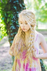 girl-playing-with-pretty-hair