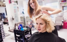 Hairdresser working on clients hair